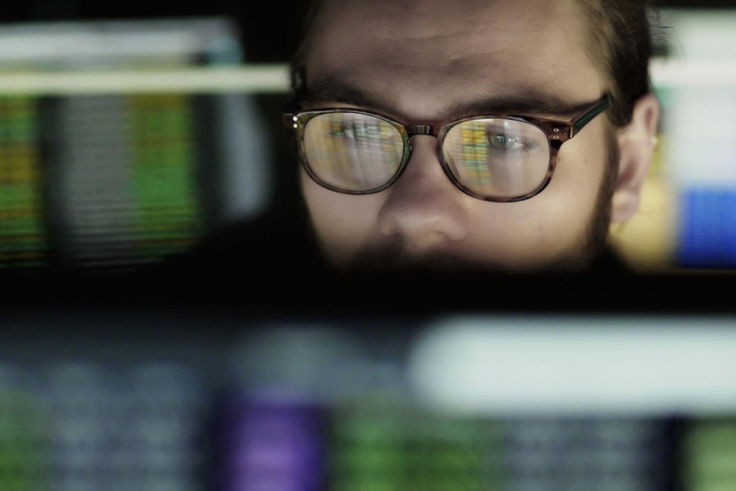 Man looking at Stock data
