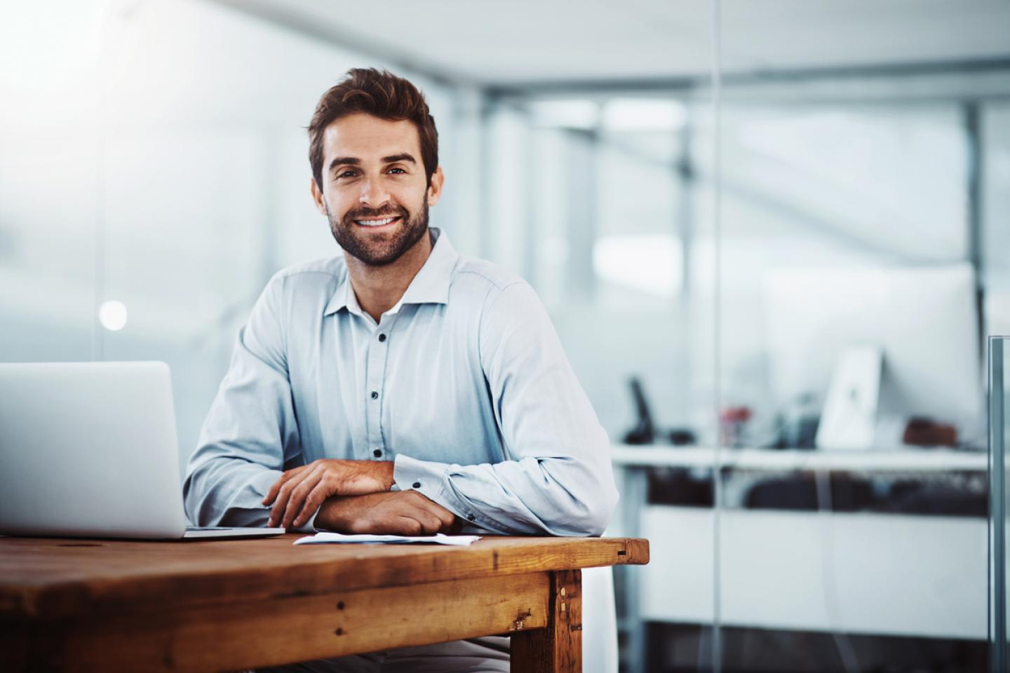 Man smiling at desk